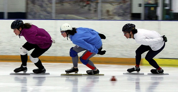 Sisters Tama, Becky, and Shana Sundstrom skate during a practice session at Mountain View Ice Arena.